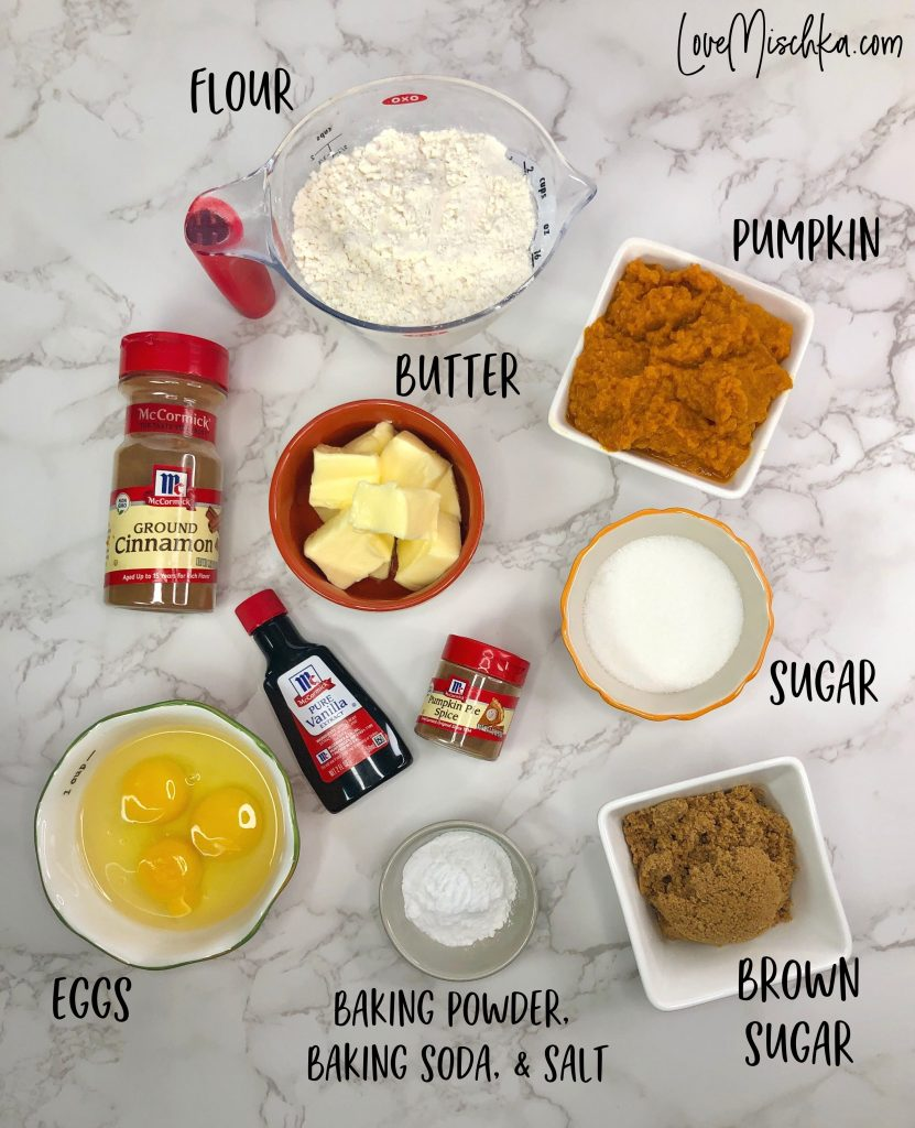 Ingredients for Pumpkin Cake laid out on a marble table.